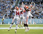 Clemson's Denzel Johnson (14), Nyles Pinckney (44), Nolan Turner (24) and Andrew Booth Jr. (23) celebrate after they stopped North Carolina on a two-point conversion in the closing moments of an NCAA college football game in Chapel Hill, N.C., Saturday, Sept. 28, 2019. (AP Photo/Chris Seward)