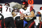 San Diego State quarterback Jordon Brookshire (4) looks for a receiver during the first half of the team's NCAA college football game against BYU on Saturday, Dec. 12, 2020, in Provo, Utah. (AP Photo/George Frey, Pool)
