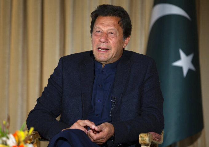 FILE - In this March 16, 2020, file photo, Pakistan's Prime Minister Imran Khan gives an interview to The Associated Press, in Islamabad, Pakistan. Khan has tested positive for Coronavirus, two days after he received his first dose, Khan's special assistance on the health Dr. Faisal Sultan said on Saturday, March 20, 2021. (AP Photo/B.K. Bangash, File)