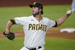 San Diego Padres' Drew Pomeranz delivers against the Los Angeles Dodgers during the seventh inning in Game 3 of a baseball National League Division Series Thursday, Oct. 8, 2020, in Arlington, Texas. (AP Photo/Sue Ogrocki)