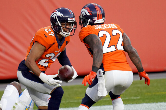 Denver Broncos cornerback Bryce Callahan (29) celebrates his interception in the end zone against the Los Angeles Chargers with strong safety Kareem Jackson (22) during the second half of an NFL football game, Sunday, Nov. 1, 2020, in Denver. (AP Photo/Jack Dempsey)