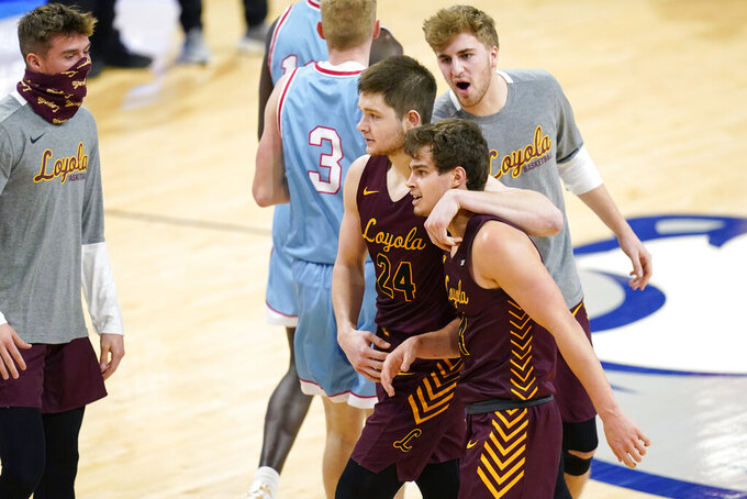 Loyola of Chicago guard Braden Norris, right, celebrates with teammate Tate Hall (24) after making a basket during the second half of an NCAA college basketball game against Drake, Saturday, Feb. 13, 2021, in Des Moines, Iowa. (AP Photo/Charlie Neibergall)