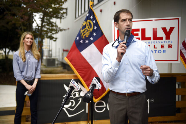 FILE - In this Oct. 12, 2020, file photo, Sen. Tom Cotton, R-Ark., right, speaks during a campaign event for Sen. Kelly Loeffler, R-Ga., left, at the Recteq facility in Evans, Ga. Six years after being elected in an expensive and heated race, Republican Sen. Tom Cotton is on the ballot again and he's campaigning hard — just not in Arkansas. (Michael Holahan/The Augusta Chronicle via AP, File)