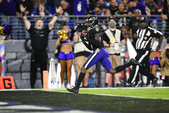 Baltimore Ravens wide receiver Marquise Brown, center, scores a touchdown during the second half of an NFL football game against the Indianapolis Colts, Monday, Oct. 11, 2021, in Baltimore. (AP Photo/Nick Wass)