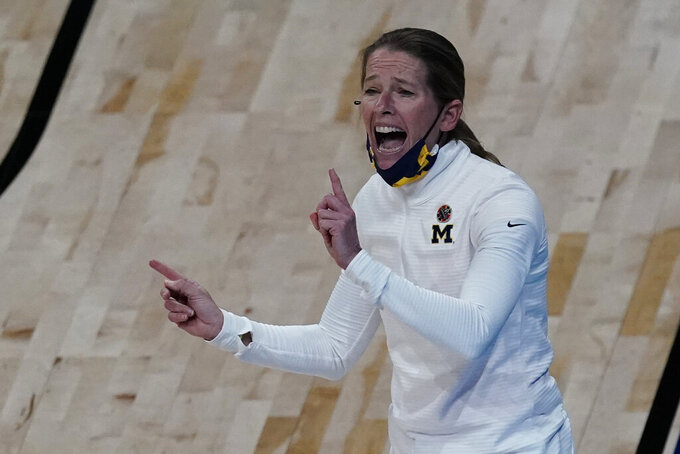 Michigan head coach Kim Barnes Arico talks to her players during the second half of a college basketball game against Tennessee in the second round of the women's NCAA tournament at the Alamodome in San Antonio, Tuesday, March 23, 2021. (AP Photo/Charlie Riedel)