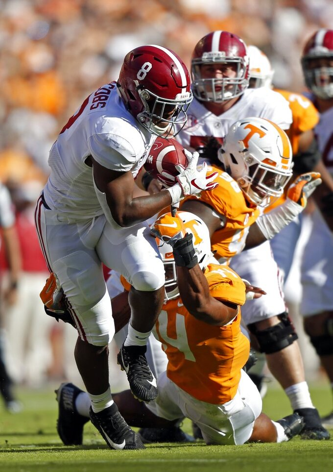 Alabama running back Josh Jacobs (8) runs for yardage as he's hit by Tennessee linebacker Quart'e Sapp (14) in the first half of an NCAA college football game Saturday, Oct. 20, 2018, in Knoxville, Tenn. (AP Photo/Wade Payne)