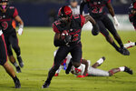 San Diego State cornerback Dallas Branch (12) runs the ball after recovering a fumble during the first half of an NCAA football game against the New Mexico Saturday, Oct. 9, 2021, in Carson, Calif. (AP Photo/Ashley Landis)