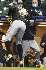 Pittsburgh Pirates' Gregory Polanco celebrates his two-run home run with manager Derek Shelton during the eighth inning of a baseball game against the Milwaukee Brewers Friday, April 16, 2021, in Milwaukee. (AP Photo/Morry Gash)