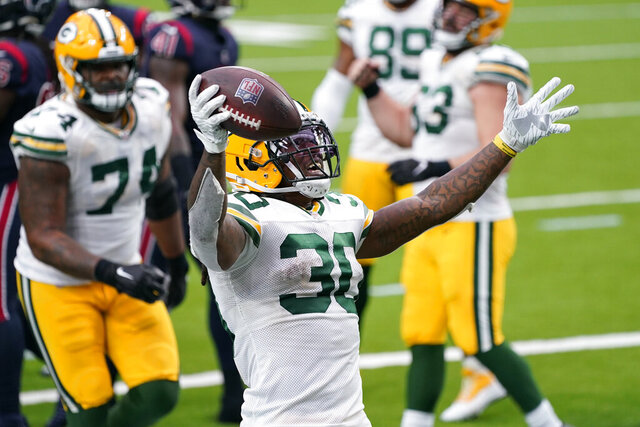 Green Bay Packers running back Jamaal Williams (30) celebrates after scoring during the second half of an NFL football game against the Houston Texans Sunday, Oct. 25, 2020, in Houston. (AP Photo/Sam Craft)