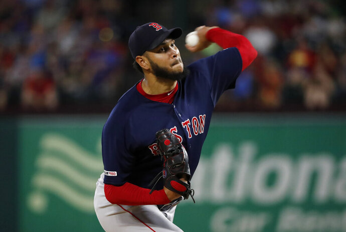 Boston Red Sox starting pitcher Eduardo Rodriguez throws to the Texas Rangers in the first inning of a baseball game in Arlington, Texas, Tuesday, Sept. 24, 2019. (AP Photo/Tony Gutierrez)