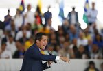 Venezuela's National Assembly President and self proclaimed interim President Juan Guaido speaks to regional and municipal leaders during a meeting in Caracas, Venezuela, Wednesday, August 21, 2019.  Guaido on Wednesday cast doubt on President Nicolas Maduro's claim that he is overseeing secret talks with the United States, saying it only reflects disarray within the Venezuelan government. (AP Photo/Leonardo Fernandez)
