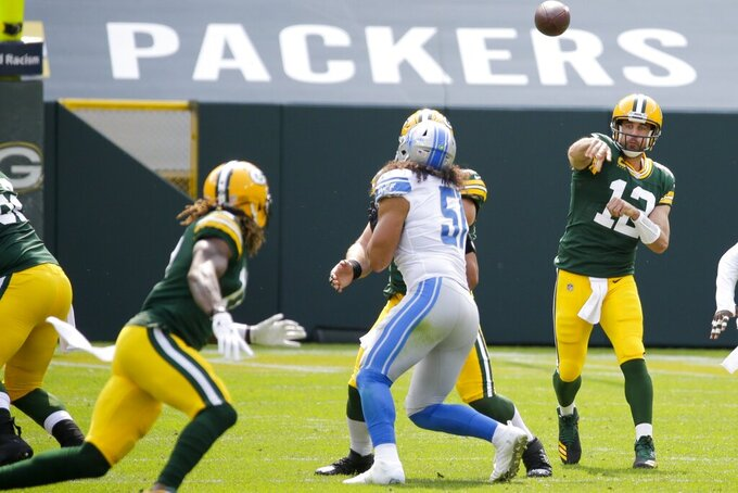Green Bay Packers' Aaron Rodgers throws during the first half of an NFL football game against the Detroit Lions Sunday, Sept. 20, 2020, in Green Bay, Wis. (AP Photo/Mike Roemer)