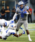 Memphis running back Darrell Henderson, right, runs over the Georgia State defender Chris Bacon during NCAA college football game action in Memphis, Tenn., Friday, Sept. 14, 2018. (Mark Weber/The Commercial Appeal via AP)