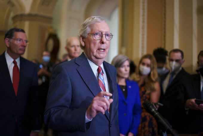 Senate Minority Leader Mitch McConnell, R-Ky., speaks to reporters as work continues on the Democrats' Build Back Better Act, massive legislation that is a cornerstone of President Joe Biden's domestic agenda, at the Capitol in Washington, Tuesday, Sept. 14, 2021. (AP Photo/J. Scott Applewhite)