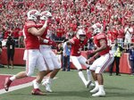 Wisconsin's Jonathan Taylor is congratulated after running for a touchdown during the first half of an NCAA college football game against New Mexico Saturday, Sept. 8, 2018, in Madison, Wis. (AP Photo/Morry Gash)