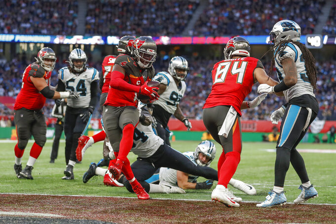 Tampa Bay Buccaneers running back Dare Ogunbowale (44) crosses the goal line for a touchdown against the Carolina Panthers during the fourth quarter of an NFL football game, Sunday, Oct. 13, 2019, at Tottenham Hotspur Stadium in London. (AP Photo/Alastair Grant)