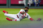 St. Louis Cardinals right fielder Dexter Fowler can't catch a ball that went for a double by Kansas City Royals' Salvador Perez during the fifth inning of a baseball game Wednesday, Sept. 23, 2020, in Kansas City, Mo. (AP Photo/Charlie Riedel)