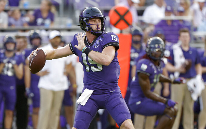 TCU quarterback Max Duggan (15) looks to throw against Duquesne during the first half of an NCAA college football game Saturday, Sept. 4, 2021, in Fort Worth, Texas. (AP Photo/Ron Jenkins)