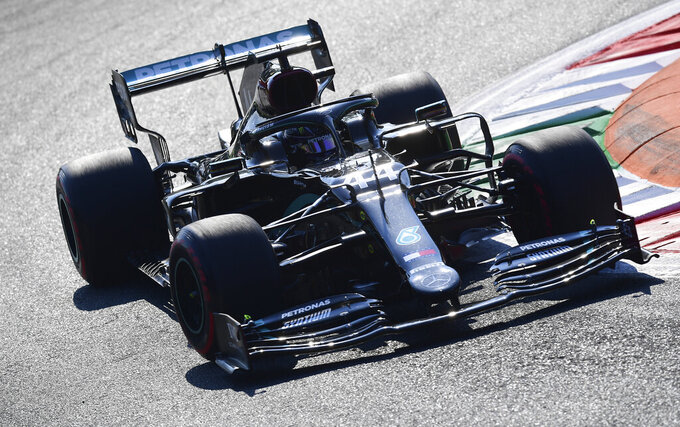 Mercedes driver Lewis Hamilton of Britain steers his car during the second practice session for Sunday's Italian Formula One Grand Prix, at the Monza racetrack in Monza, Italy, Friday, Sept. 4, 2020. (Miguel Medina/Pool via AP)