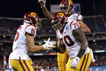 Southern California wide receiver Drake London, left, is congratulated by offensive tackle Jalen McKenzie (70) and wide receiver Michael Pittman Jr. (6) after scoring a touchdown during the first half of the Holiday Bowl NCAA college football game against Iowa, Friday, Dec. 27, 2019, in San Diego. (AP Photo/Orlando Ramirez)