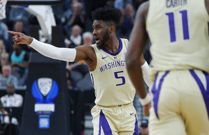 Washington's Jaylen Nowell celebrates after a play against Southern California during the first half of an NCAA college basketball game in the quarterfinal round of the Pac-12 men's tournament Thursday, March 14, 2019, in Las Vegas. (AP Photo/John Locher)