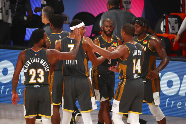 Oklahoma City Thunder forward Terrance Ferguson (23), forward Darius Bazley (7), guard Chris Paul (3), guard Devon Hall (14) and guard Luguentz Dort (5) celebrate after defeating the Washington Wizards in an NBA basketball game Sunday, Aug. 9, 2020, in Lake Buena Vista, Fla. (Kim Klement/Pool Photo via AP)