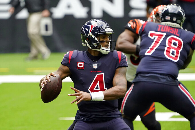 Houston Texans quarterback Deshaun Watson (4) throws a pass against the Cincinnati Bengals during the first half of an NFL football game Sunday, Dec. 27, 2020, in Houston. (AP Photo/Sam Craft)