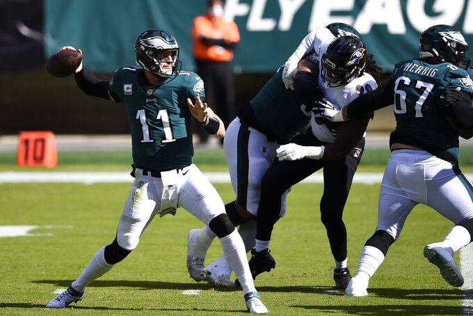 Philadelphia Eagles' Carson Wentz passes during the first half of an NFL football game against the Baltimore Ravens, Sunday, Oct. 18, 2020, in Philadelphia. (AP Photo/Derik Hamilton)