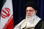 In this picture released by an official website of the Office of the Iranian Supreme Leader, supreme leader Ayatollah Ali Khamenei addresses the nation in a televised speech marking the Eid al-Adha holiday, in Tehran, Iran, Friday, July 31, 2020. Khamenei said Friday his country will not negotiate with the United States because America would only use talks for propaganda purposes. (Office of the Iranian Supreme Leader via AP)
