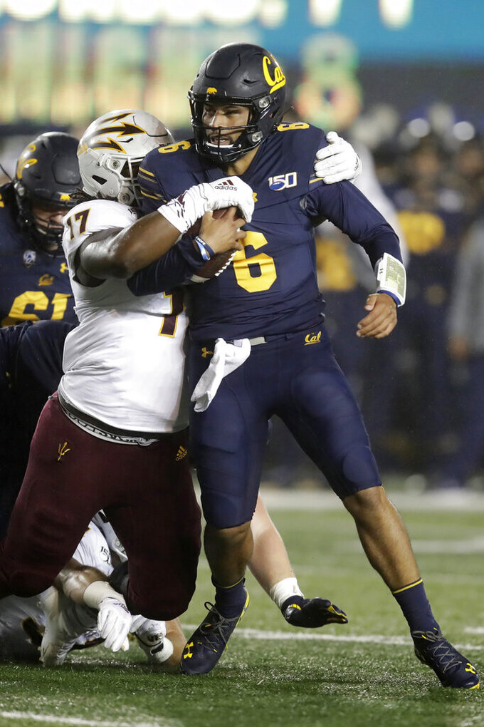 Arizona State's George Lea, left, tackles California quarterback Devon Modster (6) in the first half of an NCAA college football game, Friday, Sept. 27, 2019, in Berkeley, Calif. (AP Photo/Ben Margot)