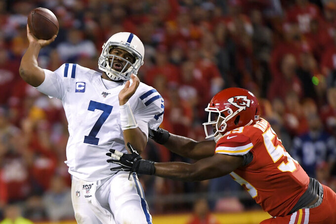 Indianapolis Colts quarterback Jacoby Brissett (7) throws under pressure from Kansas City Chiefs linebacker Reggie Ragland (59) during the second half of an NFL football game in Kansas City, Mo., Sunday, Oct. 6, 2019. (AP Photo/Reed Hoffmann)