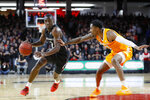 Cincinnati's Keith Williams (2) drives against Tennessee's Jordan Bowden (23) during the first half of an NCAA college basketball game, Wednesday, Dec. 18, 2019, in Cincinnati. (AP Photo/John Minchillo)