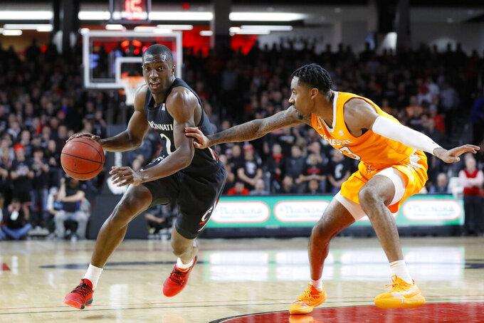 Cincinnati's Keith Williams (2) drives against Tennessee's Jordan Bowden (23) during the first half of an NCAA college basketball game, Wednesday, Dec. 18, 2019, in Cincinnati. (AP Photo/John Minchillo)