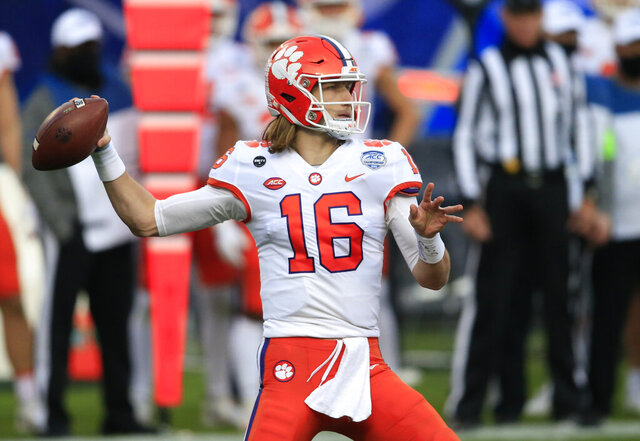 FILE - In this Saturday, Dec. 19, 2020, file photo, Clemson quarterback Trevor Lawrence (16) looks for a receiver during the first half of the Atlantic Coast Conference championship NCAA college football game against Notre Dame in Charlotte, N.C. (AP Photo/Brian Blanco, File)