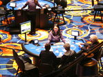 This June 25, 2018 photo shows a card game under way at the Ocean Casino Resort in Atlantic City N.J. The casino formerly known as Revel will turn a profit in May after months of steep losses. (AP Photo/Wayne Parry)