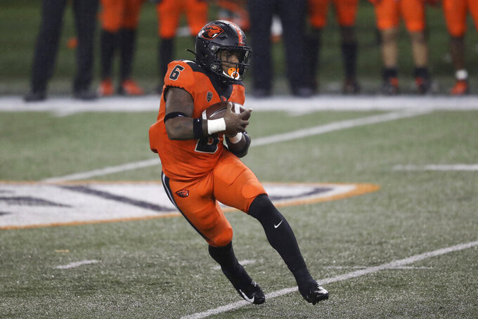 Oregon State running back Jermar Jefferson (6) rushes during the first half of an NCAA college football game against Arizona State in Corvallis, Ore., Saturday, Dec. 19, 2020. (AP Photo/Amanda Loman)