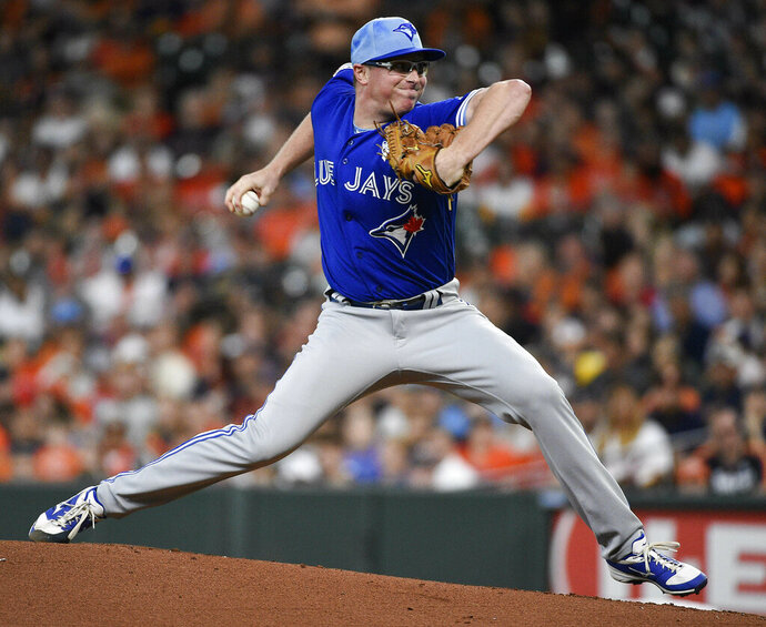 Toronto Blue Jays starting pitcher Trent Thornton delivers during the first inning of a baseball game against the Houston Astros, Sunday, June 16, 2019, in Houston. (AP Photo/Eric Christian Smith)