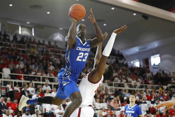 Creighton forward Damien Jefferson (23) goes up for a layup with St. John's forward Marcellus Earlington defending during the first half of an NCAA college basketball game, Sunday, March 1, 2020, in New York. (AP Photo/Kathy Willens)