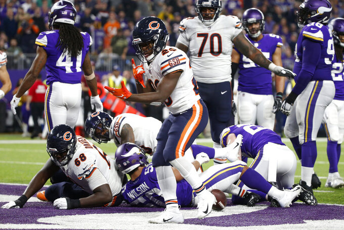 Chicago Bears running back Tarik Cohen (29) celebrates after scoring on a 3-yard touchdown run during the second half of an NFL football game against the Minnesota Vikings, Sunday, Dec. 30, 2018, in Minneapolis. (AP Photo/Bruce Kluckhohn)