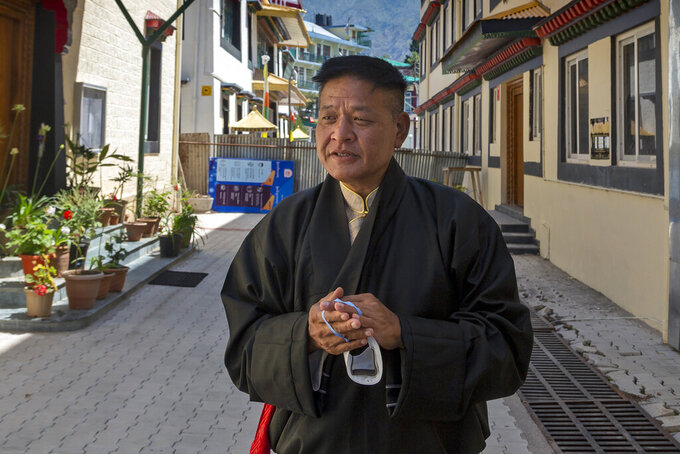 FILE - In this May 27, 2021, file photo, Penpa Tsering, the newly elected President of the Central Tibetan Administration, poses for a photograph after taking oath of office in Dharmsala, India. The new president of the Tibetan exile government said on Thursday, June 17, he will do his best to resume a dialogue with China after more than a decade, and that a visit by the Dalai Lama to Tibet could be the best step forward. (AP Photo/Ashwini Bhatia, File)