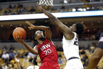 Incarnate Word's Morgan Taylor (20) shoots over Missouri's Kobe Brown during the first half of an NCAA college basketball game Wednesday, Nov. 6, 2019, in Columbia, Mo. (AP Photo/Jeff Roberson)