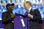 Oklahoma wide receiver Marquise Brown poses with NFL Commissioner Roger Goodell after the Baltimore Ravens Brown selected in the first round at the NFL football draft, Thursday, April 25, 2019, in Nashville, Tenn. (AP Photo/Mark Humphrey)