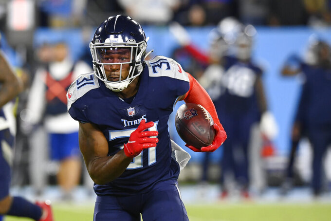 Tennessee Titans free safety Kevin Byard runs back an intercepted pass against the Buffalo Bills in the first half of an NFL football game Monday, Oct. 18, 2021, in Nashville, Tenn. (AP Photo/Mark Zaleski)