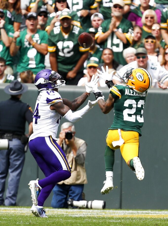 Minnesota Vikings' Stefon Diggs catches a touchdown pass with Green Bay Packers' Jaire Alexander defending during the second half of an NFL football game Sunday, Sept. 15, 2019, in Green Bay, Wis. (AP Photo/Matt Ludtke)