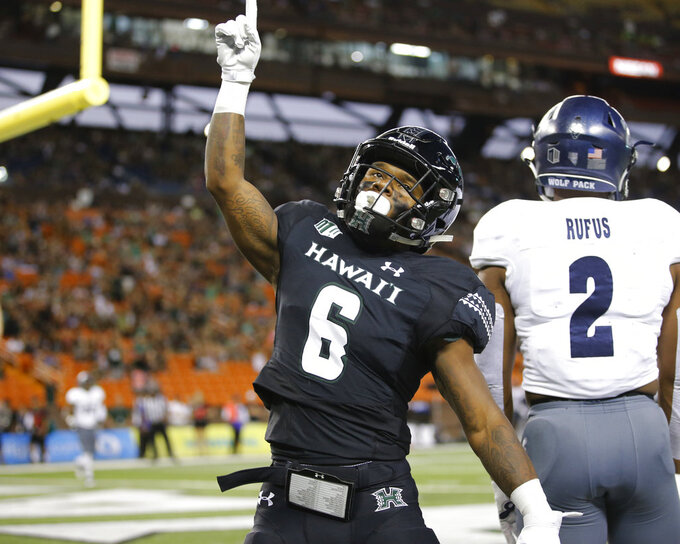 Hawaii wide receiver Cedric Byrd (6) reacts after making a touchdown against Nevada during the first half of an NCAA college football game Saturday, Oct. 20, 2018, in Honolulu. (AP Photo/Marco Garcia)