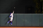 New York Mets center fielder Brandon Nimmo reaches but is unable to rob a three-run home run by Baltimore Orioles' Renato Nunez during the first inning of a baseball game, Tuesday, Sept. 1, 2020, in Baltimore. Orioles' Cedric Mullins and Jose Iglesias scored on the home run. (AP Photo/Julio Cortez)