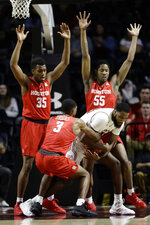 Temple's Damion Moore, right, battles for the ball with Houston's Armoni Brooks (3) as Fabian White Jr. (35) and Brison Gresham (55) defend during the first half of an NCAA college basketball game, Wednesday, Jan. 9, 2019, in Philadelphia. (AP Photo/Matt Slocum)