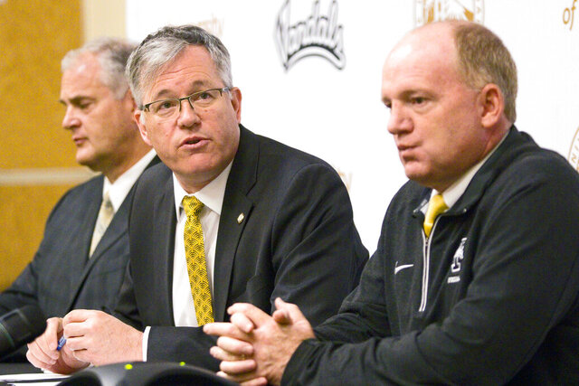 "FILE - In this April 28, 2016 file photo, University of Idaho President Chuck Staben, center, Athletic Director Rob Spear, left, and head football coach Paul Petrino answer questions during a news conference in Moscow, Idaho. Four-year colleges facing budget shortfalls stemming from the coronavirus outbreak have eliminated a total of nearly 100 sports programs since March. ""College presidents are just not thinking this through,"" former University of Idaho president Chuck Staben said. ""I cannot believe they are making all these probably bad financial decisions for their university when what we need them to do in the face of this pandemic and pending budget cuts from tuition shortfalls and state funding shortfalls is to make good financial decisions that benefit students."" (Geoff Crimmins/The Moscow-Pullman Daily News via AP, file)"