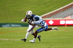 Duke  cornerback Jeremiah Lewis (39) takes down Virginia Cavaliers running back Shane Simpson (31) during an NCAA college football game Saturday, Sept. 26, 2020, in Charlottesville, Va. (Erin Edgerton/The Daily Progress via AP)