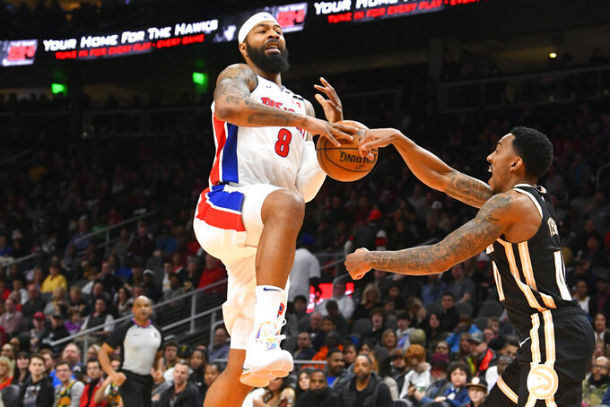 Detroit Pistons forward Markieff Morris (8) has the ball stripped from him by Atlanta Hawks guard Jeff Teague during the second half of an NBA basketball game Saturday, Jan. 18, 2020, in Atlanta. (AP Photo/John Amis)